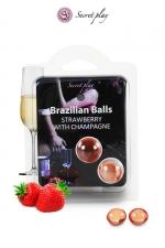 2 Brazilian Balls - fraise & champagne : La chaleur du corps transforme la brazilian ball en liquide glissant au parfum fraise & champagne, votre imagination s'en trouve exacerbée.